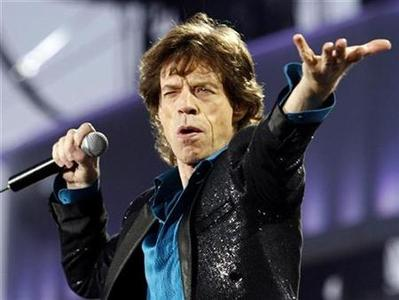 Rolling Stones lead singer Mick Jagger performs during the band's ''A Bigger Bang'' European tour stop in Lausanne, August 11, 2007. Jagger only survived an assassination attempt by Hells Angels members nearly 40 years ago because a boat carrying his would-be killers was swamped in a storm, according to a new BBC documentary. REUTERS/Denis Balibouse