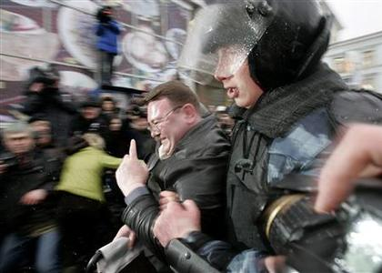 Special police detain an unidentified person as they try to prevent an unauthorized opposition march in central Moscow, March 3, 2008. REUTERS/Vasily Fedosenko