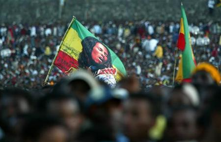 An Ethiopian Rastafarian waves a Bob Marley banner among thousands of people who gathered at Meskel Square in the capital Addis Ababa, for a concert marking Bob Marley's 60th birthday, February 6, 2005. Rita Marley is executive producing the first-ever biopic of her late husband Bob Marley, and if she has it her way, the reggae icon's daughter-in-law R&B singer Lauryn Hill will portray her onscreen. REUTERS/Antony Njuguna