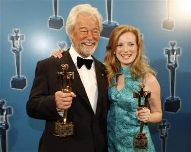Actor Gordon Pinsent (L) and director Sarah Polley hold their awards for their work in ''Away From Her'' at the 28th annual Genie Awards in Toronto March 3, 2008. REUTERS/Mark Blinch