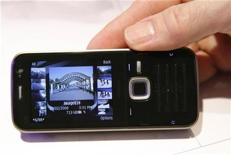 A N78 mobile by Nokia is displayed during the Mobile World Congress in Barcelona February 13, 2008. Nokia said on Tuesday it would add support to Microsoft's Silverlight Web video technology to millions of its handsets, in the latest deal between the two technology giants. REUTERS/Albert Gea