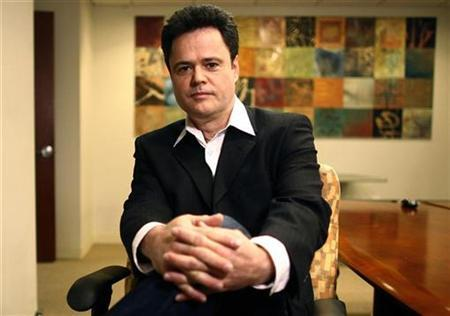 Entertainer Donny Osmond poses for a photograph in New York February 27, 2008. REUTERS/Keith Bedford