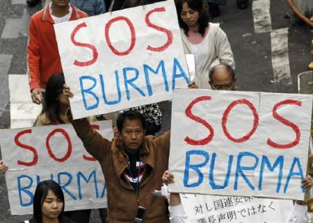 Myanmar protesters residing in Japan hold placards during a march demanding for more action from the international community against their country's military junta at Tokyo's Shibuya shopping and amusement district November 11, 2007.    REUTERS/Issei Kato