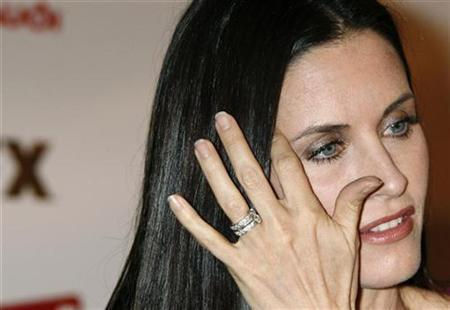 Courteney Cox arrives at the season two premiere screening of the FX cable channel series ''Dirt'' in Hollywood, California February 28, 2008. REUTERS/Fred Prouser