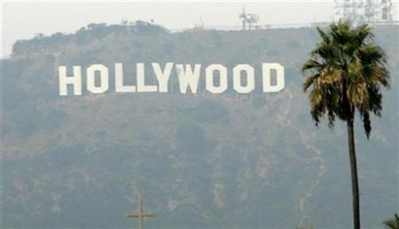 The Hollywood sign is seen on a hazy afternoon in Los Angeles, November 4, 2007. The final chapter to the tumultuous writers strike has been written, but Hollywood is bracing for a possible a sequel to the costly walkout -- this one starring film and television actors. REUTERS/Danny Moloshok