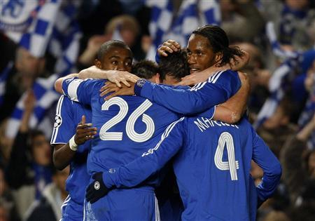 Chelsea players celebrate a goal during their Champions League first knockout round, second leg match against Olympiakos at Stamford Bridge March 5, 2008. REUTERS/Kieran Doherty
