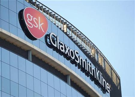 A GlaxoSmithKline logo is seen outside one of its buildings in west London, February 6, 2008. Britain is to strengthen the law on disclosing drug trial results following a four-year inquiry into GlaxoSmithKline Plc's delay in reporting data linking its antidepressant Seroxat to suicide risk in teenagers. REUTERS/Toby Melville