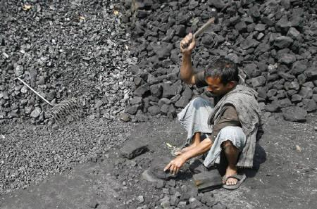 A labourer works at a wholesale coal shop in Siliguri February 27, 2008. Merrill Lynch has raised its forecasts for contract prices of coal for power plants and steel mills in 2008, predicting that prices will jump by as much as 200 percent, after recent supply disruptions resulted in a severe global shortage. REUTERS/Rupak De Chowdhuri
