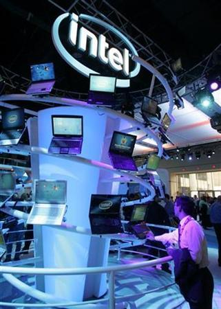 A man looks over a display of laptops at the Intel booth during the Consumer Electronics Show in Las Vegas, Nevada January 7, 2008. Intel will fight European Commission charges that it abused its dominance and gave illegal rebates to drive a smaller competitor from the market at a two-day closed hearing next week. REUTERS/Steve Marcus