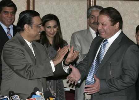 Asif Ali Zardari (L), widower of slain Pakistani opposition leader Benazir Bhutto and leader of the Pakistan People's Party, greets former prime minister Nawaz Sharif during a joint news conference in Bhurban near Islamabad, March 9, 2008. REUTERS/Faisal Mahmood