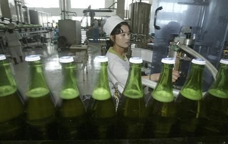 North Korean women work at the Taedonggang Beer factory in the North Korean capital Pyongyang May 3, 2004. North Korea has pursued nuclear weapons for decades, but its quest to produce decent beer began in earnest when in 2000 it started talks with Britain's Ushers brewery about acquiring its Trowbridge, Wiltshire plant that had ceased operations. REUTERS/Lee Jae-Won