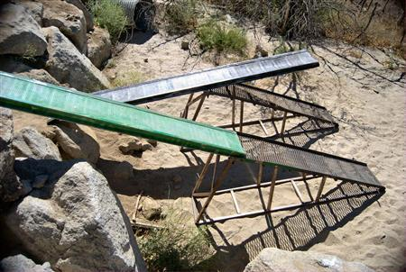 Specially constructed extendable ramp stands rest on the south side of the fence marking the U.S. and Mexico border near Campo, California in this undated file photo provided by the U.S. Border Patrol. REUTERS/U.S. Border Patrol/Handout