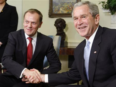 President George W. Bush (R) meets with Prime Minister of Poland Donald Tusk in the Oval Office at the White House in Washington March 10, 2008. REUTERS/Jim Young