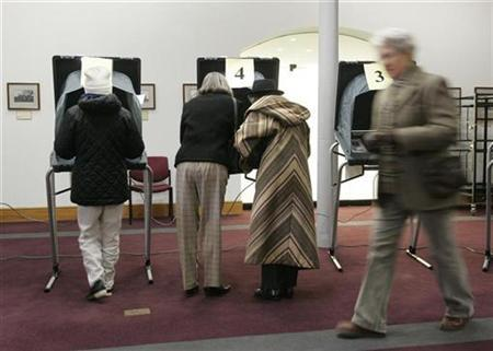Residents cast their votes in primary elections in a polling station in Alexandria, Virginia, February 12, 2008. A majority of Americans do not read political blogs, the online commentaries that have proliferated in the race for the U.S. presidency, according to a poll released on Monday. REUTERS/Molly Riley