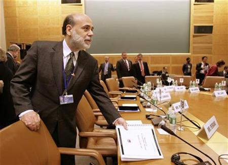 Federal Reserve Chairman Ben Bernanke at the IMF headquarters in Washington, October 20, 2007. An emergency interest rate cut from the Federal Reserve is possible ahead of its March 18th policy meeting, according to a Goldman Sachs research note on Monday. REUTERS/Yuri Gripas