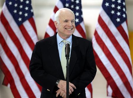 Republican presidential candidate Senator John McCain (R-AZ) speaks at a campaign event at Swift Aviation at Phoenix International Airport March 10, 2008. REUTERS/Rick Scuteri