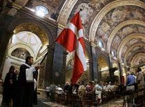 <p>Una cerimonia dei cavalieri di Malta. REUTERS/Darrin Zammit Lupi</p>