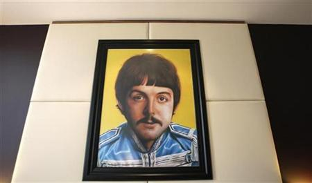 A portrait of Beatle Paul McCartney hangs on the wall in one of the rooms at the newly opened Hard Days Night Hotel in Liverpool, England February 1, 2008. Apple Inc has dismissed claims in the U.K. press that the Beatles catalog is about to be made available online through the computer giant's iTunes Music Store as ''unsubstantiated speculation.'' REUTERS/Phil Noble
