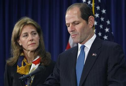 New York Governor Eliot Spitzer stands next to his wife Silda Wall Spitzer as he announces his resignation at his office in New York, March 12, 2008. REUTERS/Brendan McDermid