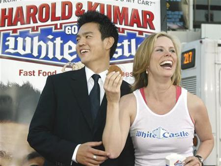 In this file photo actor John Cho, star of the new comedy film ''Harold and Kumar Go to White Castle'' poses with friend, actress Cheryl Hines at the film's premiere. Actor John Cho, star of the new comedy film ''Harold and Kumar Go to White Castle'' poses with friend, actress Cheryl Hines at the film's premiere in Hollywood July 27, 2004. When Warner Bros. takes over New Line Cinema it will first handle the comedy sequel ''Harold & Kumar Escape From Guantanamo Bay,'' which is set for an April 25 release. REUTERS/Fred Prouser