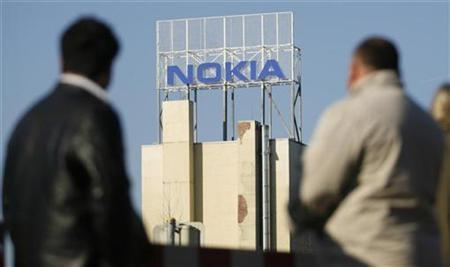 Employees walk to the change of shift at the plant of Nokia in Bochum February 12, 2008. Nokia has paid Qualcomm around $1 billion over 15 years for full access to the chip maker's early mobile technology patents, the world's top handset maker said in court documents. REUTERS/Ina Fassbender