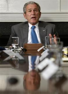 President Bush participates in a video teleconference with Afghanistan Provincial Reconstruction Team Leaders and Brigade Combat Commanders, in the Roosevelt Room at the White House, March 13, 2008. REUTERS/Jim Young