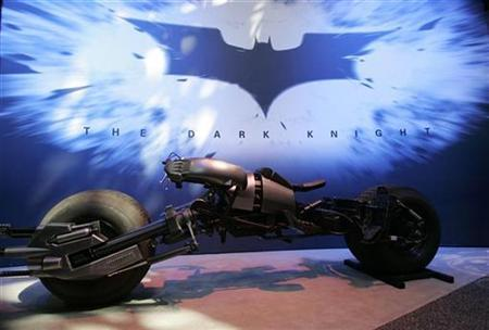 Warner Brothers unveils the Batcycle, called the Batpod in the film, for the upcoming movie ''The Dark Knight'' at the 2007 Licensing International Expo at New York's Javits Convention Center, June 19, 2007. Warner Bros. unleashed candy-coloured, neon-bright footage from a supercharged ''Speed Racer,'' promised an epic crime story in its latest Batman movie, ''The Dark Knight,'' and welcomed George Lucas back to the fold after a nearly 40-year absence Thursday. REUTERS/Jamie Fine