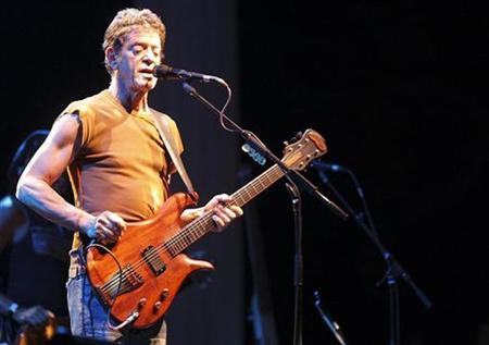 Lou Reed performs during a concert in Berlin, June 26, 2007. REUTERS/Wolfgang Rattay
