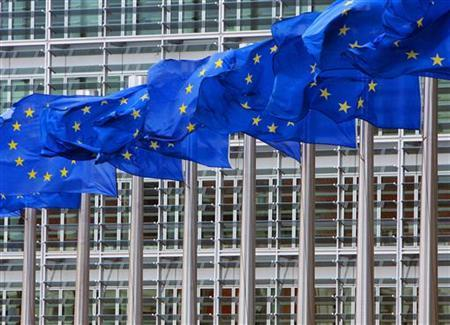 European Union flags are seen outside the European Commission headquarters in Brussels April 12, 2006. REUTERS/Yves Herman