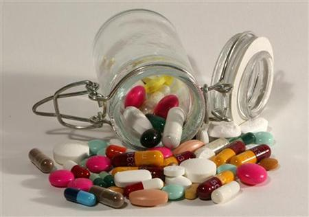 Assorted pills are seen in a file photo illustration. REUTERS/Jacky Naegelen