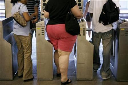 Subway riders walk through the turnstiles while leaving the U.S. Open in New York September 4, 2007. Breast cancer patients who are overweight have more aggressive disease and are likely to die sooner, U.S. researchers reported on Friday. REUTERS/Lucas Jackson