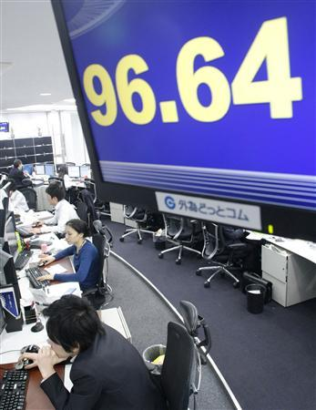 A currency dealers are seen under an electronic board showing the Japanese yen's exchange rate against the U.S. dollar in Tokyo, March 17, 2008. REUTERS/Kim Kyung-Hoon