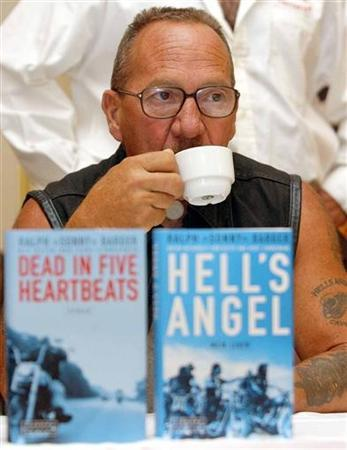 Legendary Hell's Angel Ralph ''Sonny'' Barger drinks a cup of coffee during a news conference in Vienna September 3, 2003. REUTERS/Heinz-Peter Bader