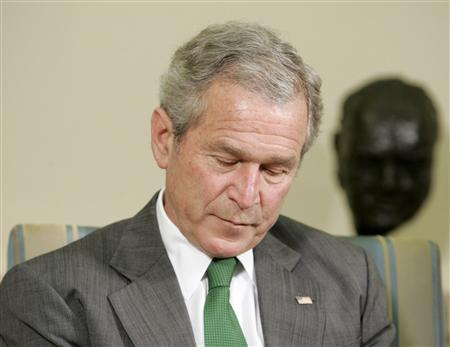 President George W. Bush pauses while speaking in the Oval Office of the White House in Washington March 17, 2008. REUTERS/Larry Downing