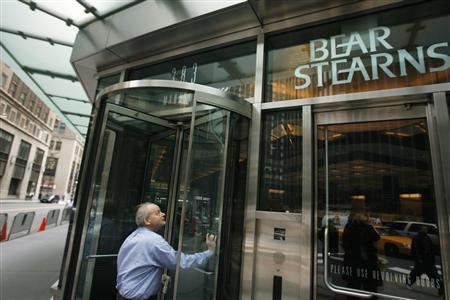 A man walks into the headquarters for Bear Stearns in New York March 14, 2008. REUTERS/Lucas Jackson