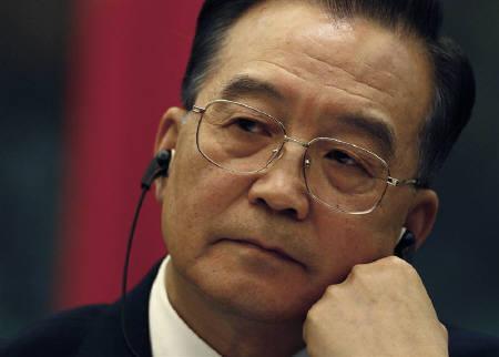 3月18日、中国の温首相(写真)はチベット騒乱鎮圧を受けて北京オリンピックのボイコット論が浮上していることに対し、オリンピックを政治問題に絡めるべきではないと訴えた。1月撮影(2008年 ロイター/Dylan Martinez)