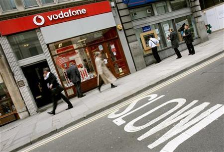 A Vodafone store in a file photo. Vodafone said on Tuesday it would make 450 redundancies within UK management but said it would recruit a similar number in data retail and other sales. REUTERS/Alessia Pierdomenico