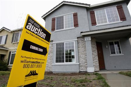 An auction sign is displayed in front of a home in Stockton, California in this February 2, 2008 file photo. REUTERS/Kimberly White/Files
