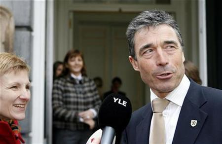 Denmark's Prime Minister Anders Fogh Rasmussen conducts a doorstep interview as he arrives for a meeting of the Prime Ministers of the European Liberal Democrat and Reform Party (ELDR) ahead of the European summit in Brussels March 13, 2008. REUTERS/Sebastien Pirlet
