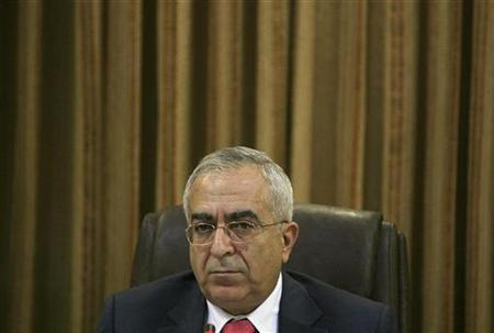 Palestinian Prime Minister Salam Fayyad attends a cabinet meeting in the West Bank city of Ramallah March 10, 2008. REUTERS/Loay Abu Haykel