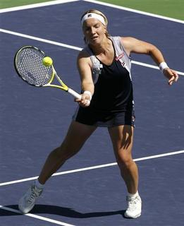 Russia's Svetlana Kuznetsova returns a volley at the net against Poland's Agnieszka Radwanska during their match at the Pacific Life Open tennis tournament in Indian Wells, California, March 19, 2008. REUTERS/Danny Moloshok