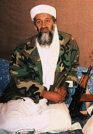 Osama bin Laden sits during an interview with Pakistani journalist Hamid Mir (not pictured) in an image supplied by the respected Dawn newspaper November 10, 2001. REUTERS/Hamid Mir/Editor/Ausaf Newspaper for Daily Dawn