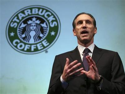 Starbucks Chief Executive Howard Schultz talks to shareholders at the Starbucks Annual Shareholders meeting at McCaw Hall in Seattle, Washington March 19, 2008. REUTERS/Marcus R. Donner