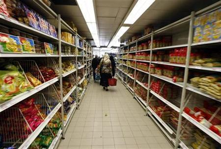 A woman walks in a food department in a supermarket in Nice southern France, February 25, 2008. REUTERS/Eric Gaillard