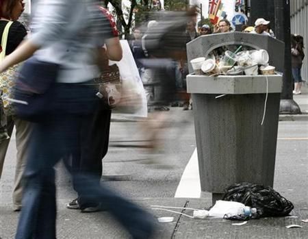 A refuse container in downtown Vancouver British Columbia is full July 23, 2007. REUTERS/Andy Clark