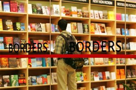 A customer browses through books at a new Borders store in Kuala Lumpur April 19, 2005. REUTERS/Bazuki Muhammad