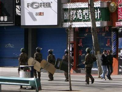 Soldiers patrol on the street in Lhasa, Tibet, March 21, 2008. REUTERS/Stringer