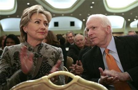 Presidential hopefuls Senator Hillary Clinton (D-NY) and Senator John McCain (R-AZ) applaud during the National Prayer Breakfast in Washington February 1, 2007. REUTERS/Kevin Lamarque