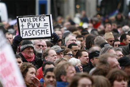 A demonstrator holds a sign during a protest against Dutch politician and anti-Islam film-maker Geert Wilders at Dam square in Amsterdam March 22, 2008. REUTERS/Ade Johnson