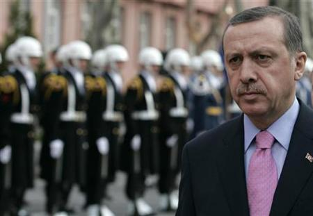 Turkish Prime Minister Tayyip Erdogan walks past a guard of honour during a ceremony in Ankara March 17, 2008. REUTERS/Umit Bektas